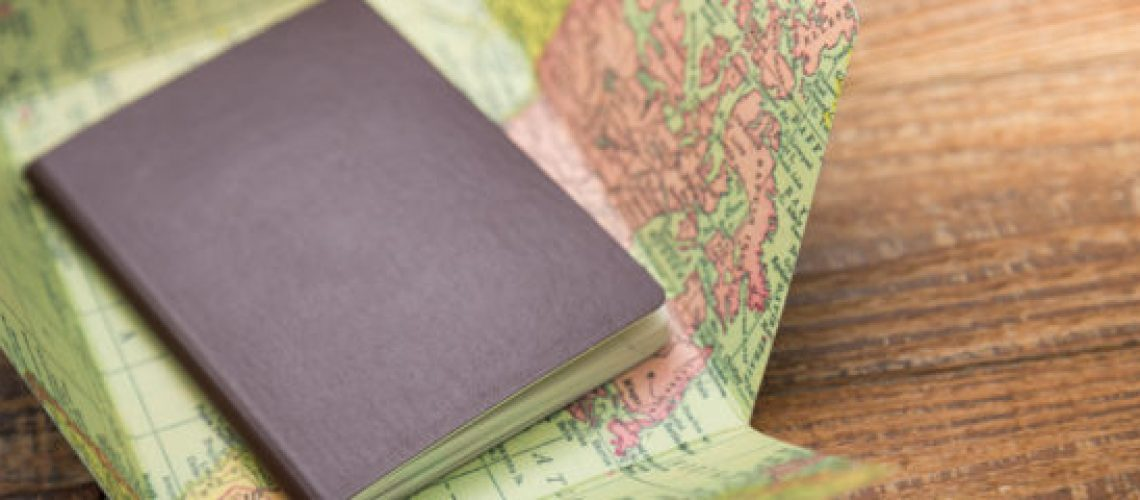 Blank passport with Map on wood table